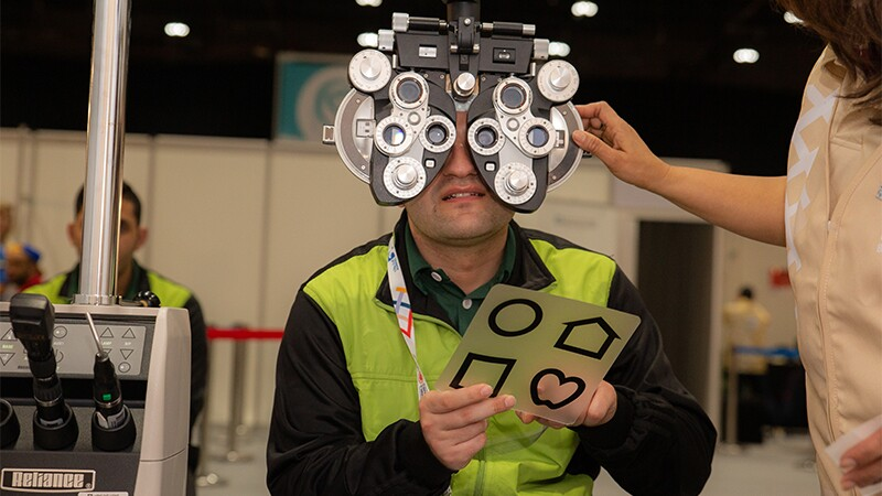 An athlete receives an eye exam at Healthy Athletes at the 2019 World Games in Abu Dhabi.