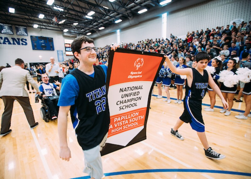 Students carry the Unified Champion School Banner at Papillion A Vista South High School