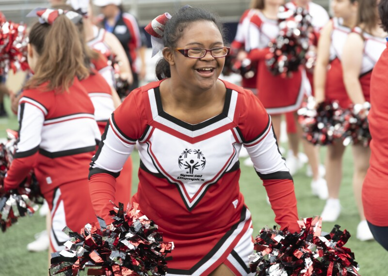 Special Olympics Cheerleader smiling