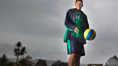 Ruaumoko Pukepuke bouncing a basketball on a court.