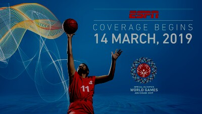Basketball player wearing #11 jumping up with the ball. The text in the background reads: ESPN coverage begins 14 March, 2019 Special Olympics World Games Abu Dhabi 2019