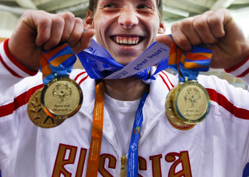 2011 World Games Athens, Greece, a Russian athlete celebrates his medals.