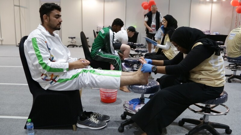 World Games Abu Dhabi 2019: athlete receiving a foot exam at a Healthy Athletes Fit Feet exhibit.