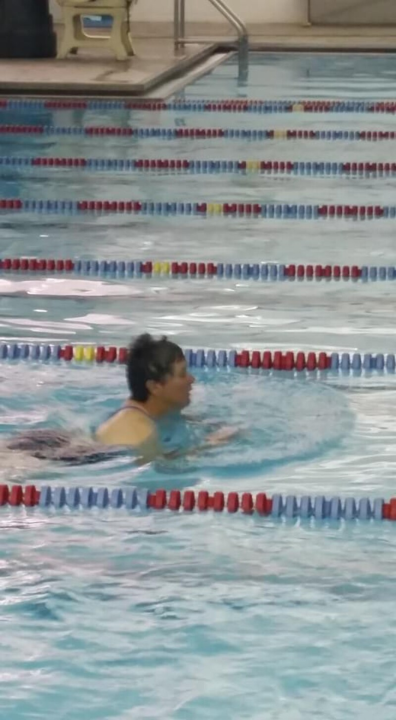 A Special Olympics athlete swims in the pool.