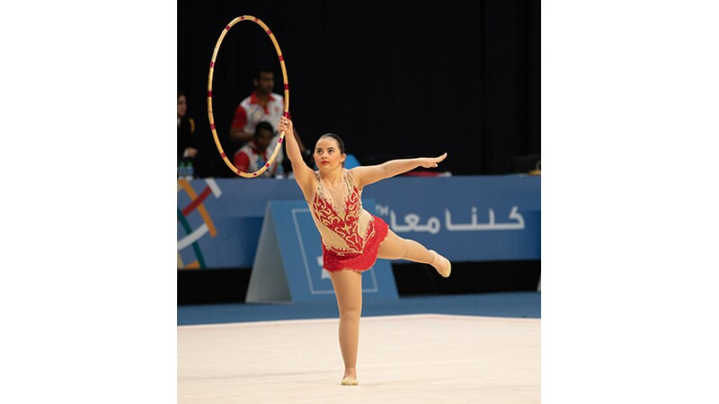 Female athlete performing with a ring.