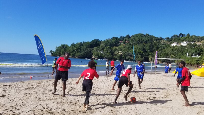 Special Olympics unified soccer/football team in a friendly match with the local beach goers in Las Cuevas, Trinidad.