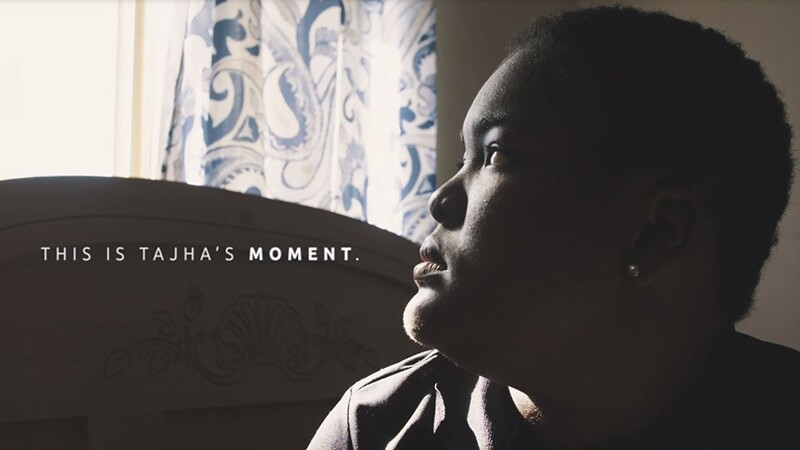 Tajha stairing off out the window. Text on the image reads: This is Tajha's moment.