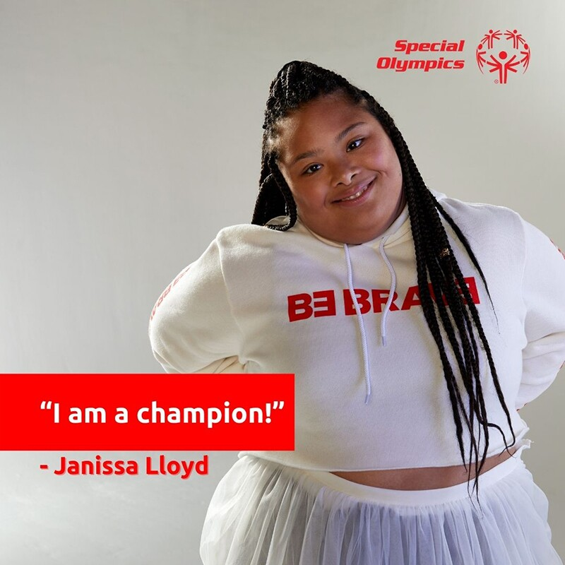 """Janissa Lloyd in a white be brave hoodie. Text reads: """"I am a champion"""" - Janissa Lloyd"""