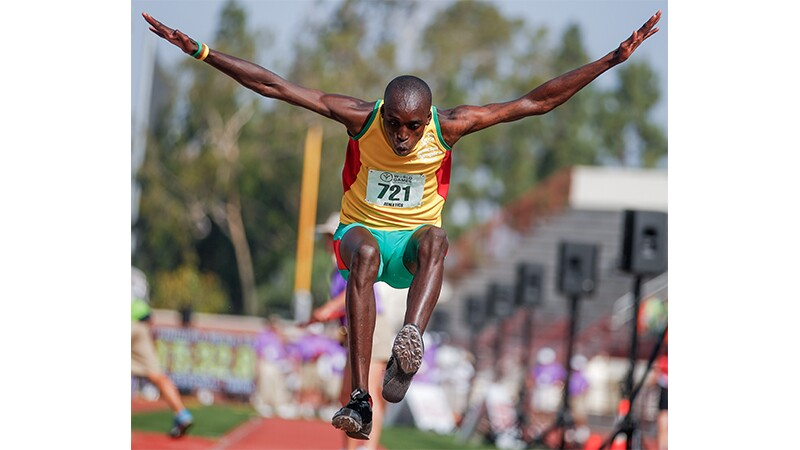 A male athlete at Special Olympics World Summer Games Los Angeles 2015 performing the long jump.