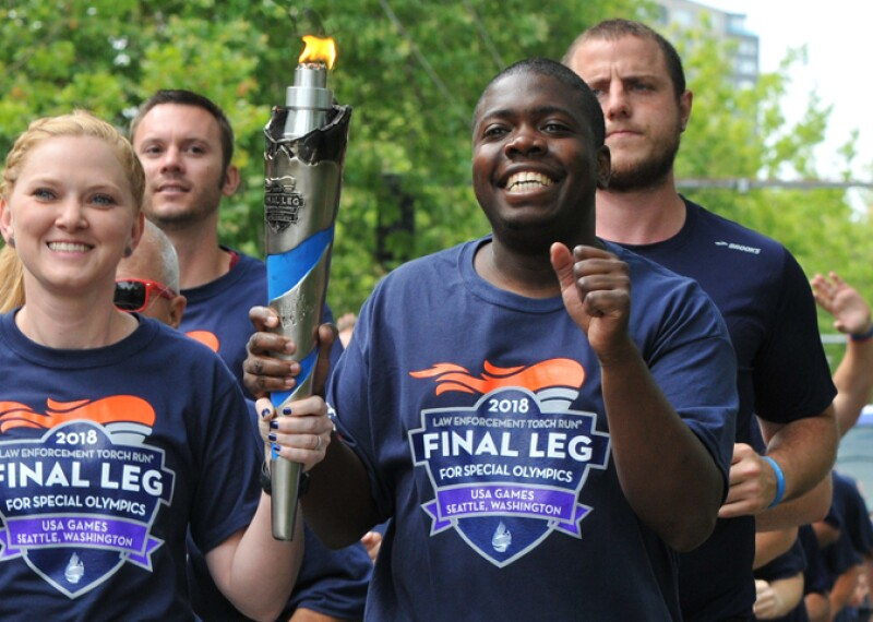 Group of runners running and holding the flame of hope.