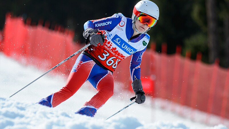 An athlete skier skiing down the hills.