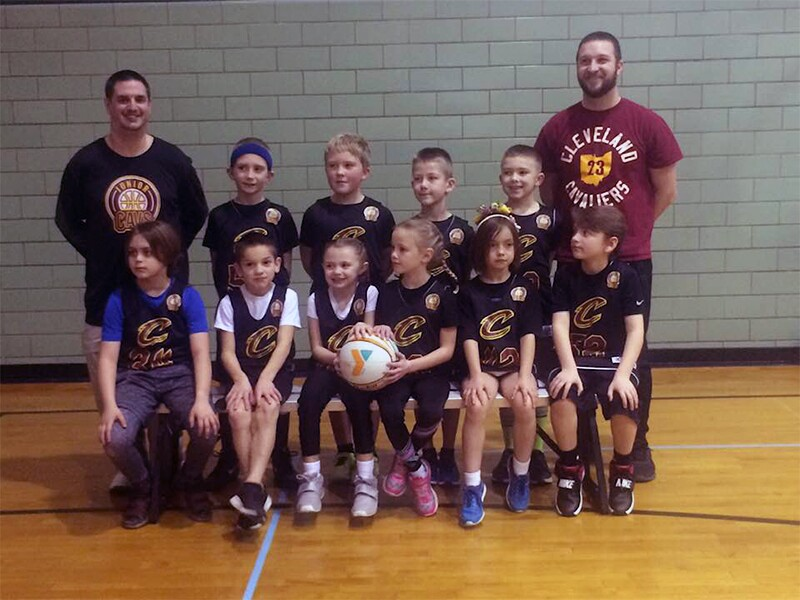 Reidl (far left) in a team picture with the 1st and 2nd graders he coaches.