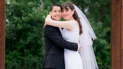 Crystal and Matthew hugging one another for a wedding photo.