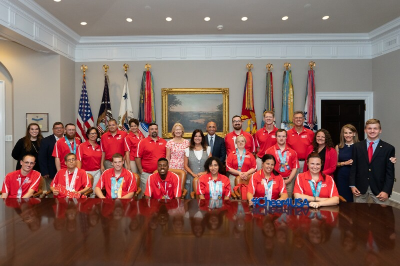 20 members of the Special Olympics USA delegation that competed at Special Olympics World Games Abu Dhabi 2019 pose in the Roosevelt Room prior to their visit with the President and Vice President.  The group of dignitaries included the Second Lady (middle), His Excellency Yousef Al Otaiba, United Arab Emirates Ambassador to the United States (right), Special Olympics CEO Mary Davis (left), and Abigial Blunt, Spouse of Senator Roy Blunt, and Charlie Blunt, son of Senator Roy Blunt (far right).
