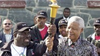 Ricardo Thornton and Nelson Mandella holding the Flame of Hope together.