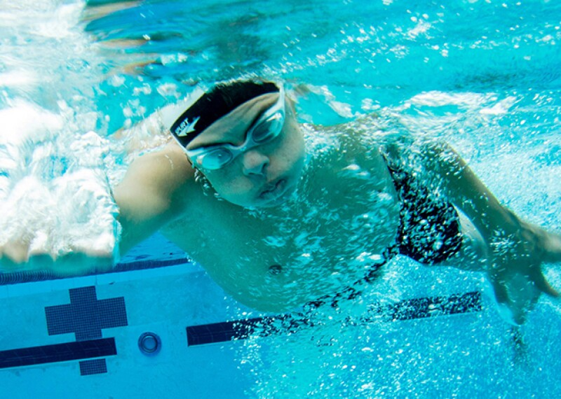 Underwater photo of an athlete swimming under water.