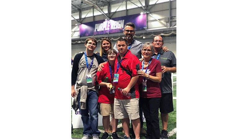 Special Olympians and Walmart representatives in a group photo at the 2018 Seattle Games.