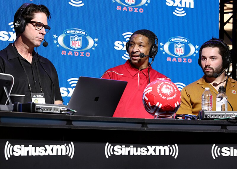 """NFL legend and SiriusXM host Ed McCaffrey interviews athlete Antrone """"Juice"""" Williams and NFL quarterback Baker Mayfield of the Cleveland Browns."""