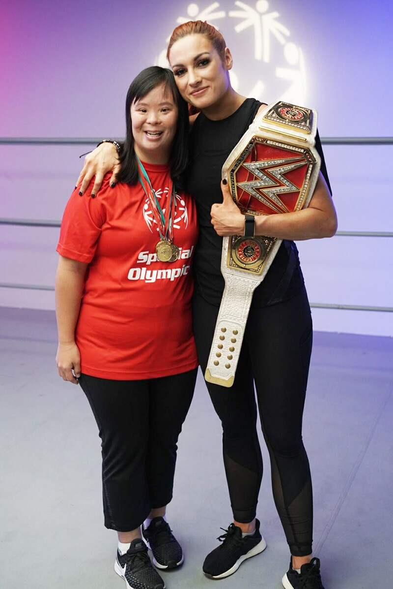 Stephanie Ching and Becky Lunch from WWE standing side by side in the ring.