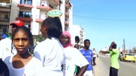athletes standing on the street in a group in Senegal.