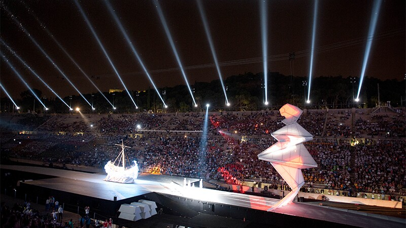 Opening ceremony performance in a stadium full of spectators.