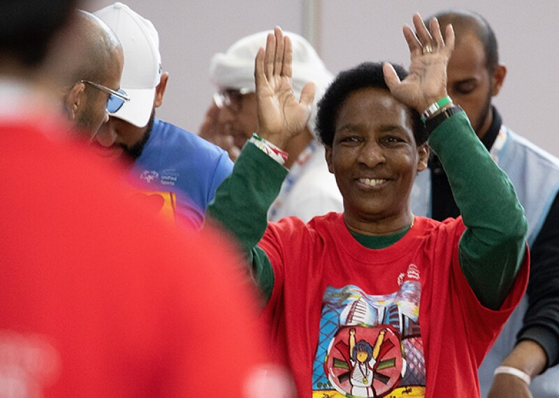 Loretta Claiborne, Special Olympics Board Vice Chair and Chief Inspiration Officer smiling with hands in the air.