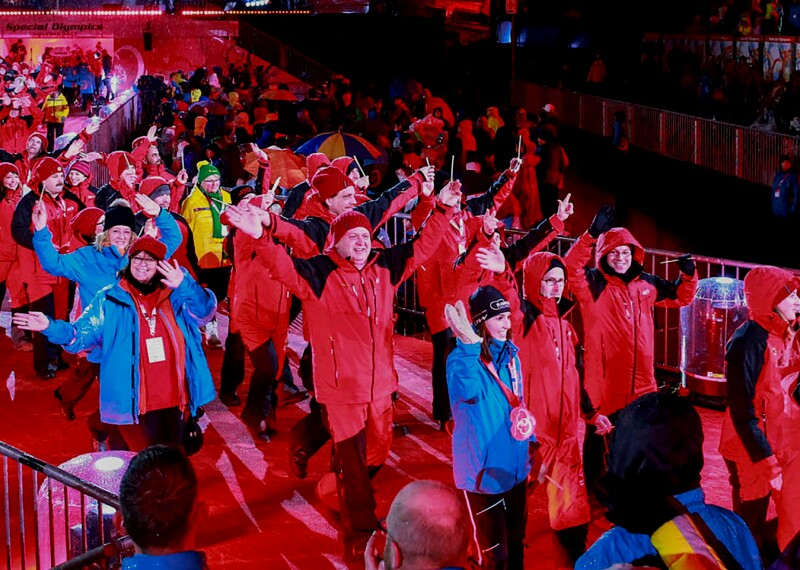 Athletes walking into a stadium during the opening of a Special Olympics World Games.