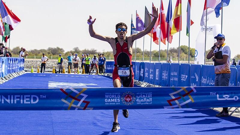 Triathlon runner preparing to cross the finish line.