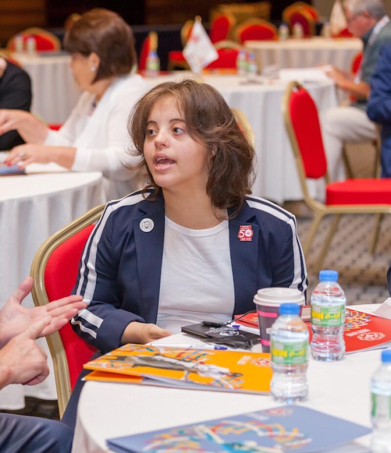 Chaica Al Qassim at a reception table at an Abu Dhabi World Games event