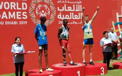 Special Olympics Bosnia and Herzegovina athlete Njegoš Mihajlović on the podium of the 400m race at the Abu Dhabi World Games 2019