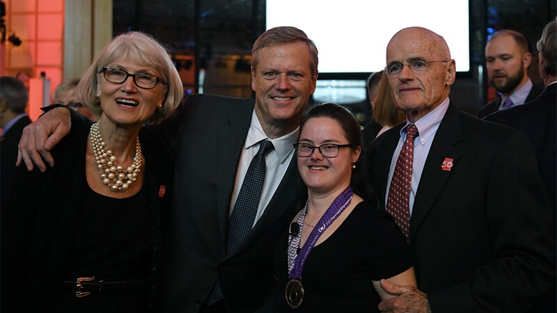 Melissa Reilly and her parents standing with current Governor Charlie Baker.