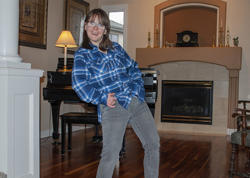 Hanna Joy Atkinson dancing in her living room.