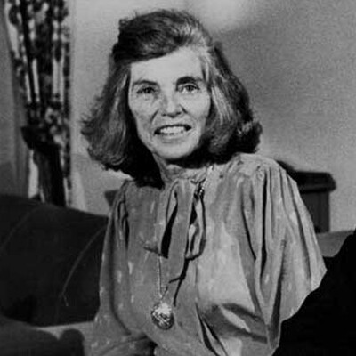 Eunice Kennedy Shriver smiling in a black and white photo