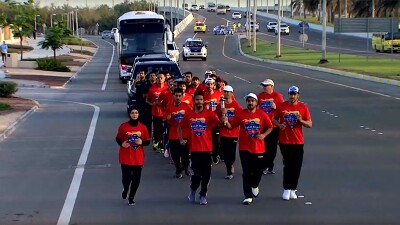Runners running down the street