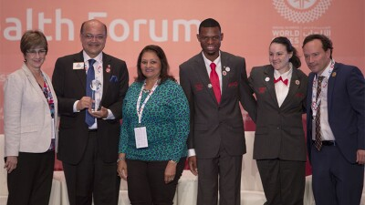 A small group of 6 Special Olympics representatives including two Sargent Shriver International Global Messengers standing together.